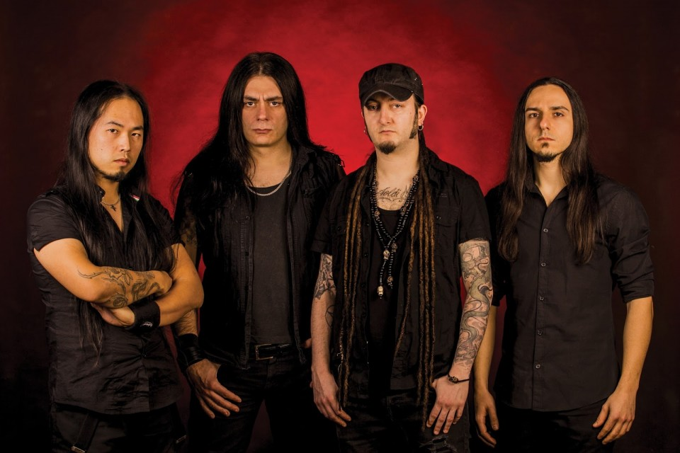 Forgotten Tomb's press photo — Forgotten Tomb take forced break due to frontman's injury