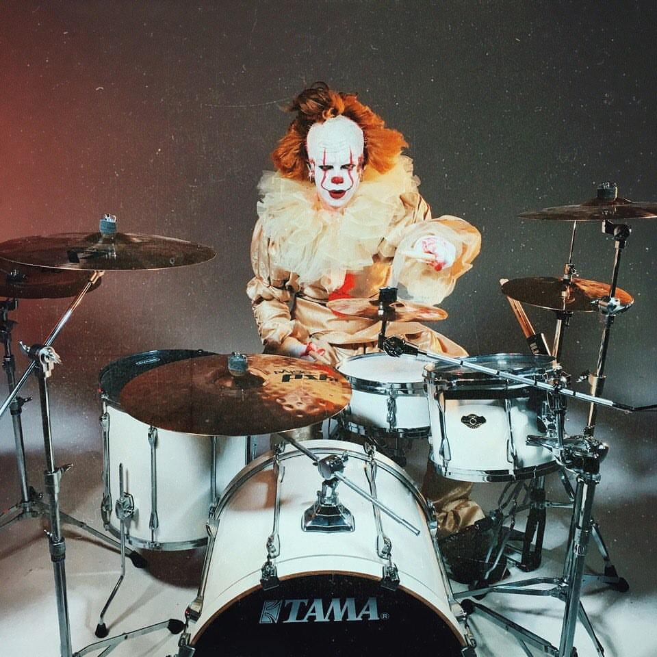 Musician performs drum cover for Slipknot song dressed as